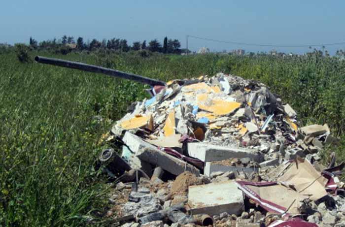 תמונת נמחשה  - תיעוד השלכת פסולת בשטחים פתוחים בצפון